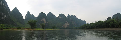 Li Jiang river and its mounts. Li Jiang river and its mountains - Guilin - China - Panorama Royalty Free Stock Photo