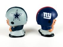 Li`L Teammates Toys, Cowboys vs. Giants Figures. Li`L Teammates Toys, Cowboys and Giants Figures on a white backdrop Royalty Free Stock Images