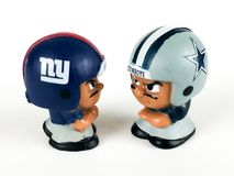 Li`L Teammates Toys, Giants and Cowboys Figures. On a white backdrop Royalty Free Stock Photo