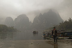 Li River,Guilin,China, 22th, March, 2014, boatman stands on the Royalty Free Stock Photo