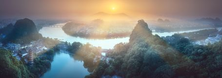 Li River and Karst mountains Guilin, Yangshuo. Arial view of Guilin, Li River and Karst mountains Yangshuo during sunrise with sun rays Guangxi Province, China Stock Images