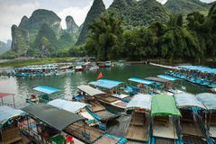 Li River Lijiang River. Pleasure boats at the pier in Xingping. Town Royalty Free Stock Images