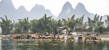 The Li River or Lijiang is a river in Guangxi Zhuang Autonomous Region, China. Guilin, China - Jan 29, 2013: Bamboo rafting in winter is a popular tourism Royalty Free Stock Images