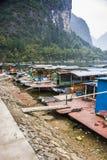 The Li River or Lijiang is a river in Guangxi Zhuang Autonomous Region, China. Guilin, China - Jan 29, 2013: Old bamboo boat home park along along Li River Stock Images