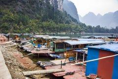 The Li River or Lijiang is a river in Guangxi Zhuang Autonomous Region, China. Guilin, China - Jan 29, 2013: Old bamboo boat home park along along Li River Stock Photography