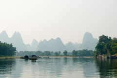 Li River mountains. Li River, in Yangshuo, China.  Limestone mountains can be seen in the background Stock Photo