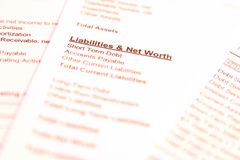 Liabilities. Financial documents with focus on words Liabilities & Net Worth. Very easy to shift colours Stock Photos