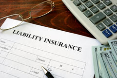 Liability insurance form and dollars. Stock Images