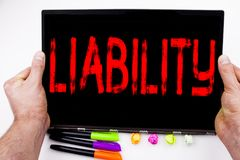 Liability text written on tablet, computer in the office with marker, pen, stationery. Business concept for Accountability Legal B. Lame Risk white background Royalty Free Stock Images