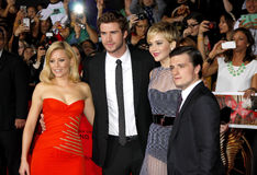 Liam Hemsworth, Elizabeth Banks, Jennifer Lawrence and Josh Hutcherson. At the Los Angeles premiere of The Hunger Games: Catching Fire held at the Nokia Theatre Royalty Free Stock Photo