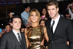 Liam Hemsworth, Josh Hutcherson, Jennifer Lorenzo fotografía de archivo libre de regalías
