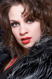 Lianne cover. Portrait of the woman in a fur fur coat and a bright evening make-up. A photo in vertically focused for a cover of magazine Royalty Free Stock Photography