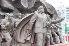 LIAONING, CHINA - 28 Juli 2015: Het Vrijwilligersleger S van Chinese Mensen stock afbeelding
