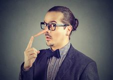 Liar business man with long nose royalty free stock photography