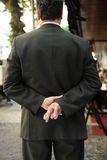 Liar: businessman with fingers crossed. Behind his back Stock Images