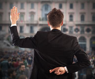 Liar businessman. Man makes gesture with hand behind back Stock Photos
