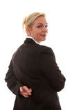 Liar businesswoman with crossed fingers at back Royalty Free Stock Image