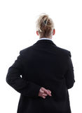 Liar businesswoman with crossed fingers at back. Over white background Stock Photos