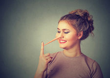 Liar concept. Happy woman with long nose. Human face expression emotion Stock Photo