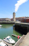 The Liar`s tower in Dunkirk, France. Dunkirk, France - May 31, 2017: Recreational boats and the old Liar`s Tower in the old harbor of Dunkirk, France on May 31 Stock Images