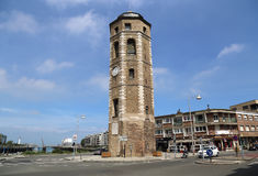 The Liar`s tower in Dunkirk, France. Dunkirk, France - May 31, 2017: The Liar`s tower or Tour du Leughenaer, a car and a person on a bicycle in the old harbor of Royalty Free Stock Photo