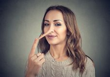 A liar woman with long nose royalty free stock photography