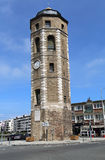 The Liars tower in Dunkirk, France. Dunkirk, France - May 31, 2017: The Liar`s tower or Tour du Leughenaer, a car and a person on a bicycle in the old harbor of Royalty Free Stock Photo