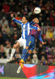Liassine Cadamuro(L) vies with Dani Alves(R) Royalty Free Stock Photography