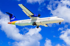 Liat ATR 72. ATR 72 of Liat (Leeward Islands Air Transport Services), a Caribbean airline, approaching to land Stock Images
