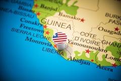 Libéria identificou por meio de uma bandeira no mapa fotografia de stock