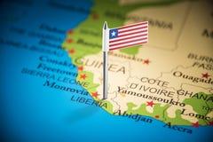 Libéria identificou por meio de uma bandeira no mapa fotos de stock