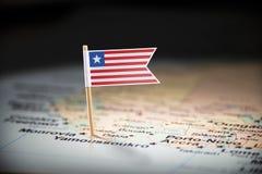 Libéria identificou por meio de uma bandeira no mapa fotografia de stock royalty free