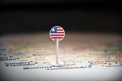 Libéria identificou por meio de uma bandeira no mapa imagens de stock