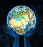 Libanon op aarde in handen Stock Fotografie