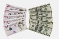 Libbre britanniche e dollari Fotografia Stock