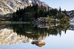Libby Lake Reflection Sunrise in the Snowy Range Mountains of Wy stock photography