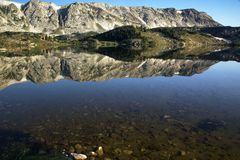 Libby Lake Calm Sunrise in the Snowy Range Mountains of Wyoming stock photo