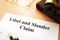 Libel and Slander Claims. Libel and Slander Claims on a desk Royalty Free Stock Photos