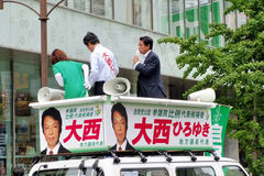 Liberal Democratic Party. JULY 6 - OSAKA: Campaigner Onishi Hiroyuki from the Japanese Liberal Democratic Party (LDP) prepare for the Election for the House of stock images