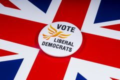 Liberal Democrats Political Party in the UK. London, UK - November 20th 2018: A Liberal Democrats political party badge, pictured over the flag of the United stock photography