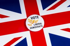 Liberal Democrats Political Party in the UK. London, UK - November 20th 2018: A Liberal Democrats political party badge, pictured over the flag of the United stock photo