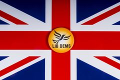 Liberal Democrats Political Party in the UK. London, UK - November 20th 2018: A Liberal Democrats political party badge, pictured over the flag of the United stock photos