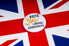 Liberal Democrats Political Party in the UK. London, UK - November 20th 2018: A Liberal Democrats political party badge, pictured over the flag of the United stock images