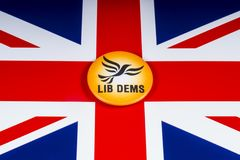Liberal Democrats Political Party in the UK. London, UK - November 20th 2018: A Liberal Democrats political party badge, pictured over the flag of the United stock image