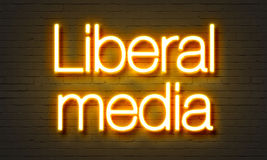 Liberal media neon sign on brick wall background. Royalty Free Stock Photos