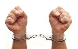 Liberandosi delle manette Immagini Stock Libere da Diritti