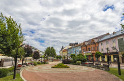 The Liberation Square in Michalovce city, Slovakia. MICHALOVCE, SLOVAKIA - JULY 3, 2017: The Liberation Square Slovak: Namestie osloboditelov, the central square Stock Image