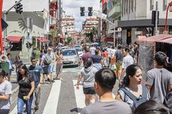 Liberdade, Sao Paulo SP Brazil. Sao Paulo SP, Brazil - March 03, 2019: People at the stores and commerce on the Galvao Bueno street, at Liberdade neighborhood stock image