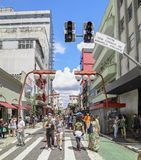 Liberdade, Sao Paulo SP Brazil. Sao Paulo SP, Brazil - March 03, 2019: People at the stores and commerce on the Galvao Bueno street, at Liberdade neighborhood stock photography