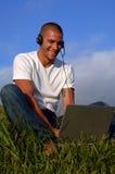 Libere el teléfono en el ordenador Foto de archivo libre de regalías